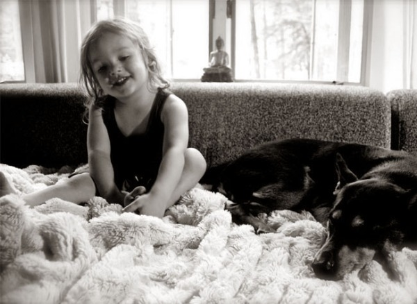 Busybee designer-in-training, 2-year-old Miles Grey, enjoying one of our faux fur throws at home with best friend Sasha.